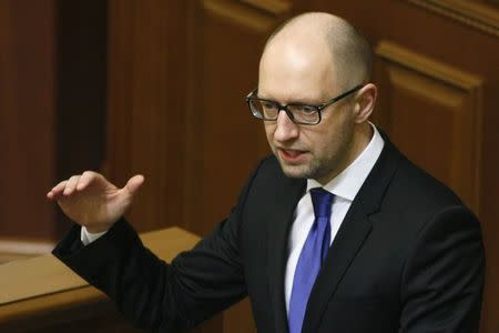 Ukraine's Prime Minister Yatseniuk speaks to deputies as he presents a work plan of his government during a parliament session in Kiev