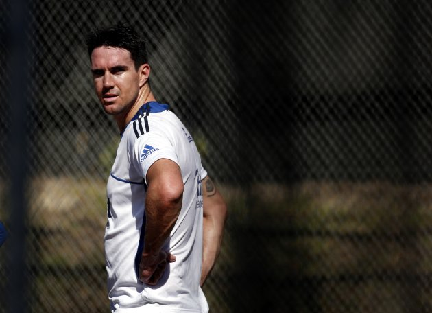 England cricket team player Pietersen talks with teammates during a team training session in Wellington