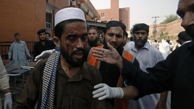 Man who was injured during a bomb blast arrives at a hospital in Peshawar