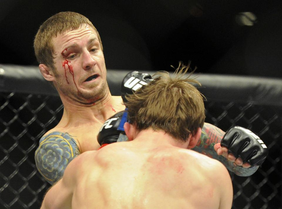Eddie Wineland, left, connects with Brad Pickett during their UFC 155 bantamweight bout at the MGM Grand Garden Arena Saturday, Dec, 29, 2012 in Las  Vegas. Wineland won the match by a split decision. (AP Photo/David Becker)