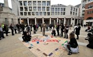 File photo shows protesters playing a giant game of Monopoly outside the London Stock Exchange in central London on the eve of the G20 economic crisis summit on April 2, 2009. Protests against corporate power that have taken hold in the US are to hit Britain on Saturday with a rally in front of the London Stock Exchange, organisers revealed