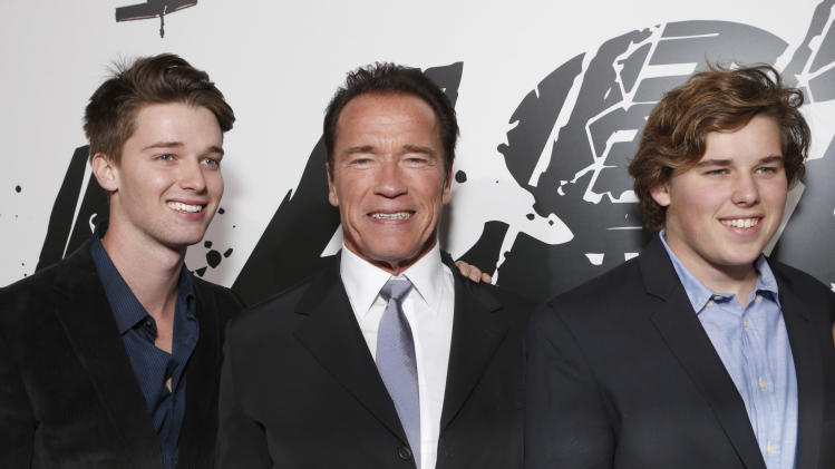 """Patrick Schwarzenegger, Arnold Schwarzenegger and Chris Schwarzenegger attend the LA premiere of """"The Last Stand"""" at Grauman's Chinese Theatre on Monday, Jan. 14, 2013, in Los Angeles. (Photo by Todd Williamson/Invision/AP)"""