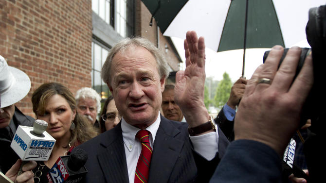 Rhode Island Gov. Lincoln Chafee, center, arrives at the state's Economic Development Corp. headquarters, Monday, May 21, 2012, in Providence, R.I. Former Boston Red Sox pitcher Curt Schilling and Rhode Island's economic development agency met Monday to discuss the finances of his troubled video game company. (AP Photo/Steven Senne)