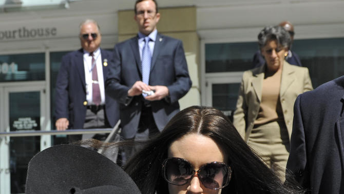 Casey Anthony leaves the federal courthouse in Tampa, after a bankruptcy hearing Monday, March 4, 2013.  Anthony, 26,  has not made any public appearances since she left jail after being acquitted in the murder of her two-year-old daughter Caylee.  She filed for bankruptcy in Florida in late January, claiming about $1,000 in assets and $792,000 in liabilities. Court papers list Anthony as unemployed, with no recent income. (AP Photo/Brian Blanco)