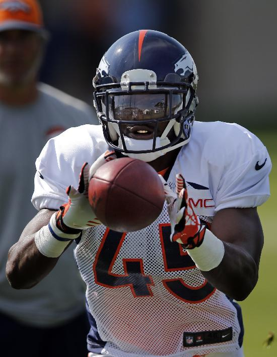 Denver Broncos' Jerome Murphy eyes the ball while running a drill during NFL football training camp on Monday, July 28, 2014, in Englewood, Colo