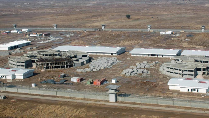 FILE -  In this June 2007 file photograph taken by the United States Army Corps of Engineers and released by the Special Inspector General for Iraq Reconstruction, the Khan Bani Saad Correctional Facility, about 20 kilometers (12 miles) northeast of Baghdad, is seen from the air. Ten years and $60 billion in taxpayer funds later, Iraq is still so unstable and broken that even its leaders question whether U.S. efforts to rebuild it were worth the cost. n Iraq's eastern Diyala province, a crossroads for Shiite militias, Sunni insurgents and Kurdish squatters, the U.S. began building a 3,600-bed prison in 2004 but abandoned the project after three years to flee a surge in violence. The half-completed Khan Bani Sa'ad Correctional Facility cost American taxpayers $40 million but sits in rubble, and Iraqi Justice Ministry officials say they have no plans to ever finish or use it. (AP Photo/Special Inspector General for Iraq Reconstruction, File)