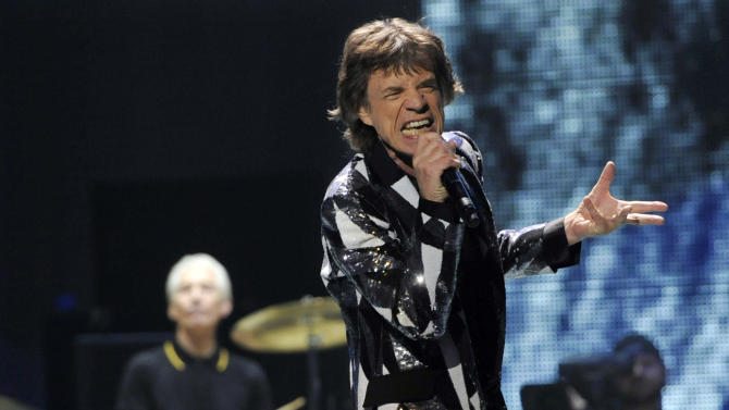 """This May 3, 2013 file photo shows Mick Jagger of the Rolling Stones performing on the kickoff of the band's """"50 and Counting"""" tour at the Staples Center in Los Angeles. The Green Valley High School choir in Henderson, Nev., will join the Stones at the MGM Grand Garden Arena in Las Vegas Saturday, May 11, for the encore performance of their hit song, """"You Can't Always Get What You Want.'"""" (Photo by Chris Pizzello/Invision/AP)"""