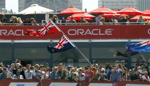 Fans of Emirates Team New Zealand cheer after their team defeated Oracle Team USA during Race 11 of the 34th America's Cup yacht sailing race in San Francisco