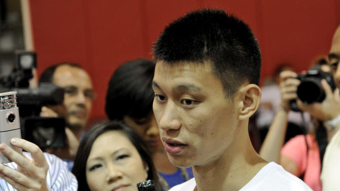 Houston Rockets' player Jeremy Lin speaks with the media after NBA basketball practice, Tuesday, Sept. 18, 2012, in Houston. (AP Photo/Pat Sullivan)