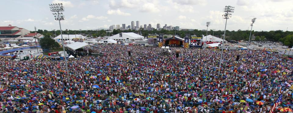 Crowds are seen at the New Orleans Jazz and Heritage Festival in New Orleans, Saturday, May 5, 2012. (AP Photo/Gerald Herbert)