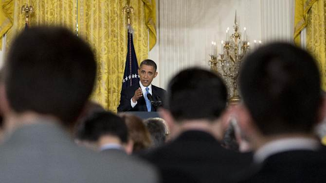 President Barack Obama gestures as he answers reporters questions during the final news conference of his first term in the East Room of the White House in Washington, Monday, Jan. 14, 2013. (AP Photo/Carolyn Kaster)