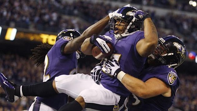 Baltimore Ravens running back Ray Rice (C) is lifted up by team-mates after scoring the Ravens' first touchdown of the 2012 NFL season against the Cincinnati Bengals (Reuters)