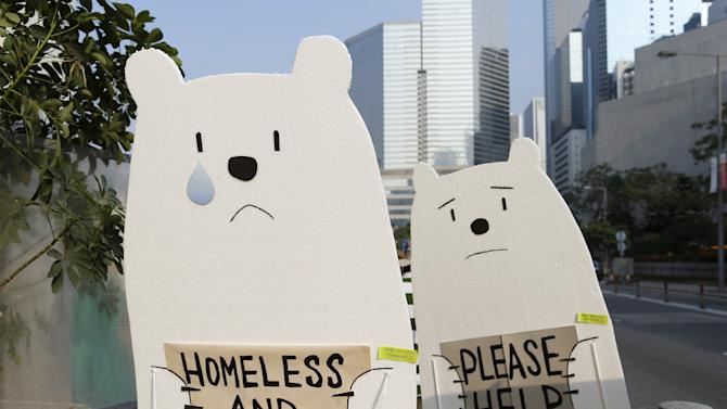 Protesters carry styrofoam cut-outs depicting polar bears during a march ahead of the 2015 Paris Climate Change Conference, known as the COP21 summit, in Hong Kong