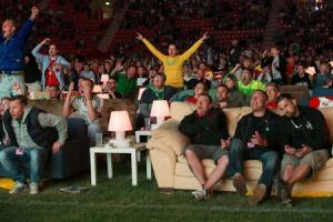 People react as Brazil scores against Croatia during a public viewing of the opening game of the 2014 World Cup at Alte Foersterei stadium in Berlin