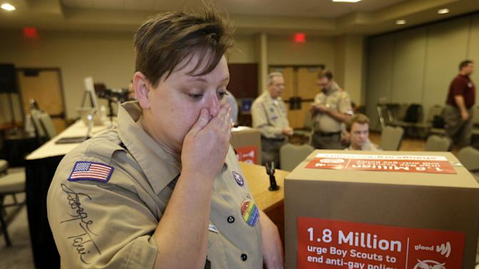 Former Cub Scouts den leader Jennifer Tyrrell, who was ousted from Scouting because she is openly gay, becomes emotional as she responds to a reporters question Thursday, May 23, 2013, in Grapevine, Texas. Local leaders of the Boy Scouts of America voted Thursday to ease a divisive ban and allow openly gay boys to be accepted into the nation's leading youth organization — one of the most dramatic moves the organization has made in a century. (AP Photo/Tony Gutierrez)