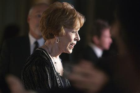 Burnett talks to reporters as she arrives on the red carpet before being presented the 2013 Mark Twain Prize for American Humor at the Kennedy Center in Washington