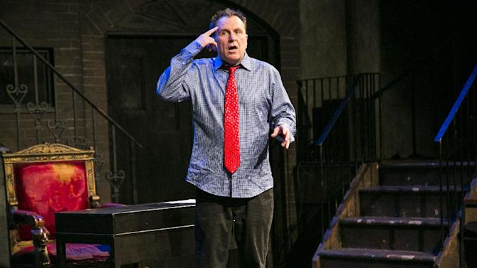 "This theater image released by Keith Sherman and Associates shows Colin Quinn performing his one-man show, ""Colin Quinn Unconstitutional,"" in New York. (AP Photo/Keith Sherman and Associates, Mike Lavoie)"