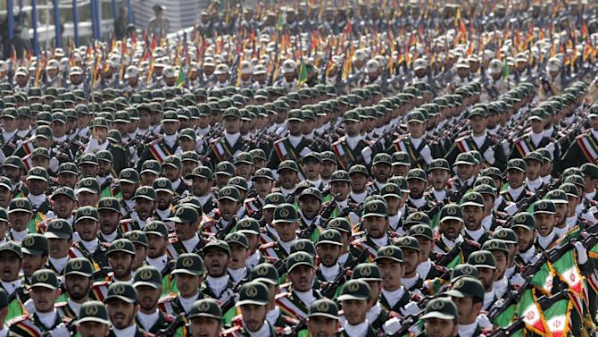 Iran's Revolutionary Guard troops march, during a military parade commemorating the start of the Iraq-Iran war 32 years ago, in front of the mausoleum of the late revolutionary leader Ayatollah Khomeini, just outside Tehran, Iran, Friday, Sept. 21, 2012. (AP Photo/Vahid Salemi)