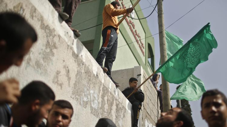 Palestinians Hamas supporters take part in a protest in front of the Egyptian embassy in Gaza