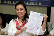 Senator Loren Legarda files her certificate of candidacy at the Commission on Elections office in Intramuros, Manila Oct. 1. (Joseph Vidal, NPPA Images)