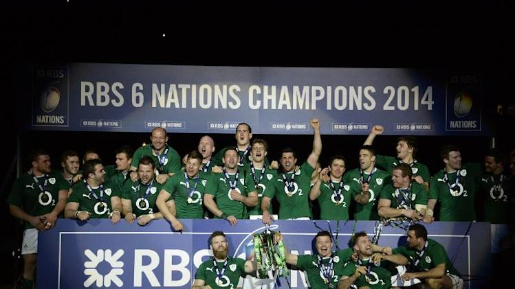 Ireland's players celebrate with their medals and trophy after winning a Six Nations rugby union match against France on March 15, 2014 at the Stade de France in Saint-Denis, north of Paris