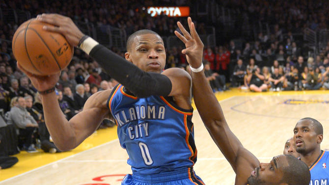 Oklahoma City Thunder guard Russell Westbrook, left, goes up for a shot as forward Antawn Jamison defends during the first half of their NBA basketball game, Friday, Jan. 11, 2013, in Los Angeles. (AP Photo/Mark J. Terrill)