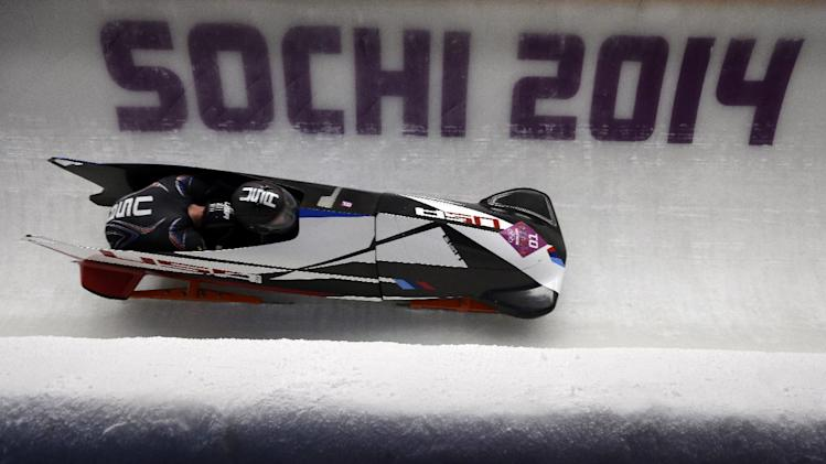 The team from the United States USA-1, piloted by Steven Holcomb and brakeman Steven Langton, take a curve during the men's two-man bobsled competition at the 2014 Winter Olympics, Monday, Feb. 17, 2014, in Krasnaya Polyana, Russia