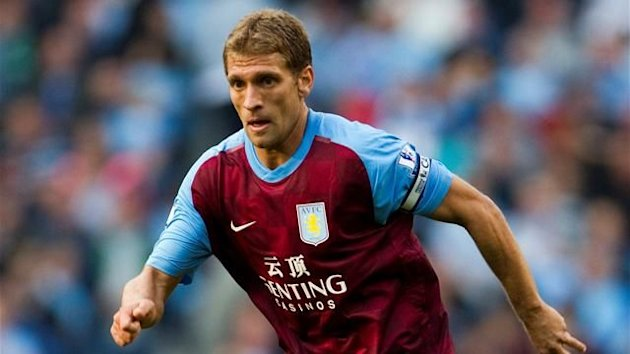 Aston Villa's Bulgarian player Stiliyan Petrov controls the ball during an English Premier League football match against Manchester City at The City of Manchester stadium