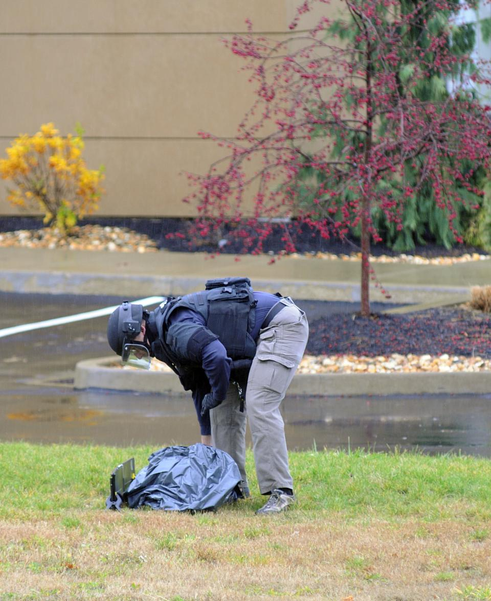 Pennsylvania State Police Bomb squad investigator examines personal belongings of Oscar Ramiro Ortega-Hernandez , arrested in connection with shots fired at the White House, Wednesday, Nov. 16, 2011 in Indiana, Pa.  (AP Photo/The Indiana Gazette, James J. Nestor)