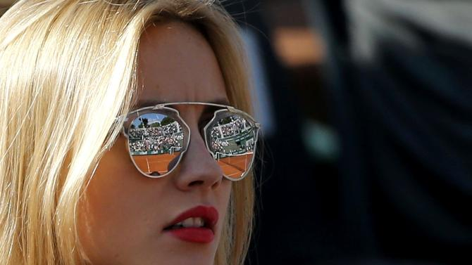 The court is reflected in the glasses of Ester Satorova, the girlfriend of Tomas Berdych of Czech Republic, as she watches his men's singles match against compatriot Radek Stepanek at the French Open tennis tournament at the Roland Garros stadium in Paris