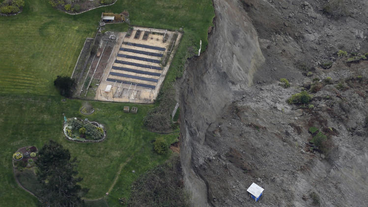 This aerial photo shows a garden area at the edge of a landslide near Coupeville, Wash. on Whidbey Island, Wednesday, March 27, 2013. The slide severely damaged one home and isolated or threatened more than 30 on the island, about 50 miles north of Seattle in Puget Sound. No one was reported injured in the slide, which happened at about 4 a.m. Wednesday. (AP Photo/Ted S. Warren)