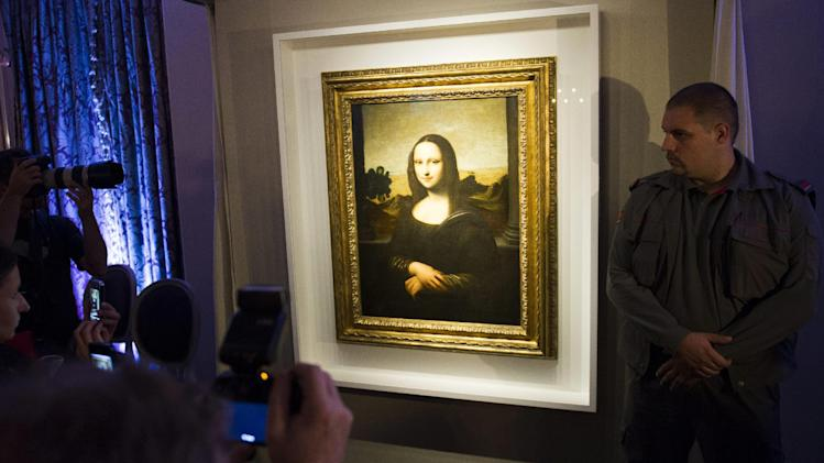 A painting attributed to Leonardo da Vinci representing Mona Lisa, is displayed during a presentation in Geneva, Switzerland, Thursday, Sept.27, 2012. The Mona Lisa Foundation, a non-profit organization based in Zurich, presents a painting and historical, comparative and scientific evidence, which demonstrates that there have always been two portraits of the Mona Lisa by Leonardo da Vinci, the 'Earlier Version,' made ten years earlier than the 'Joconde' that is displayed in Le Louvre in Paris, France. (AP Photo/Keystone, Yannick Bailly)