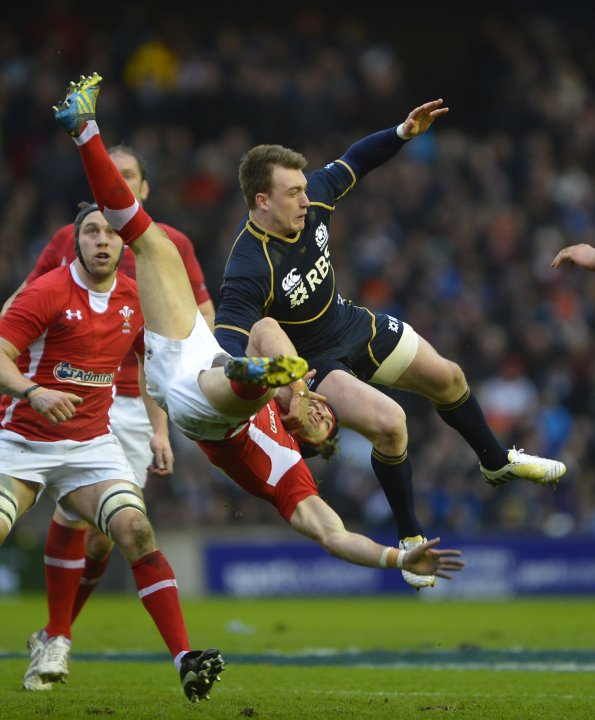 Scotland's Stuart Hogg challenges Wales' Leigh Halfpenny to a high ball during their six nations rugby union match in Edinburgh