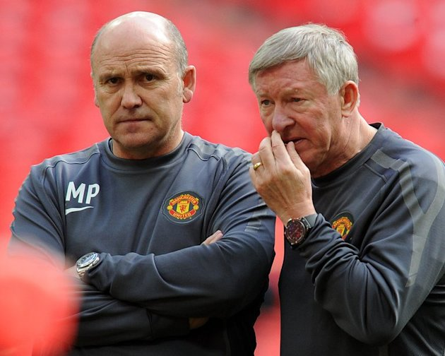Then-Manchester United manager Alex Ferguson (L) speaks with Assistant Coach Mike Phelan on May 27, 2011