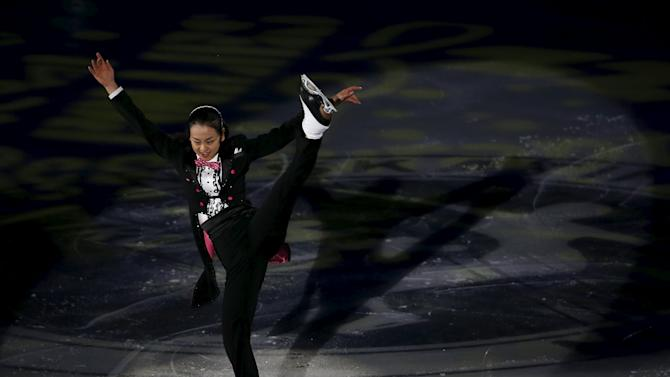 Asada of Japan performs during the gala exhibition at the ISU Grand Prix of Figure Skating in Nagano