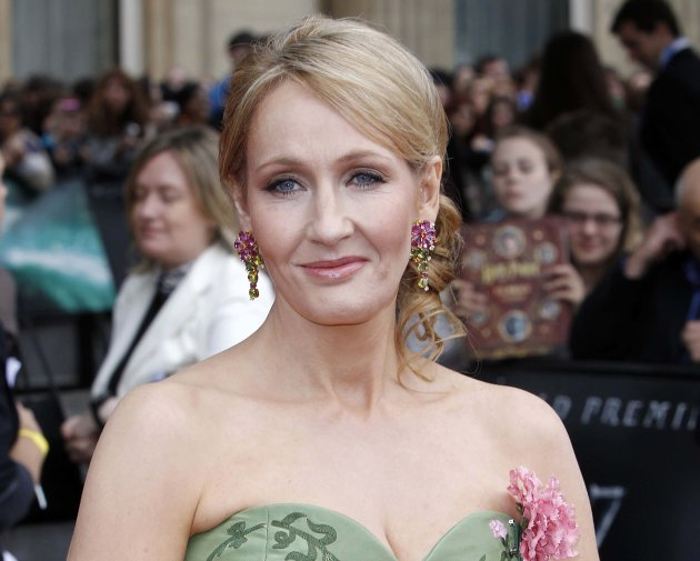 "FILE - This July 7, 2011 file photo shows British author JK Rowling at the world premiere of ""Harry Potter and The Deathly Hallows: Part 2,"" in London. Rowling's next book is for adults, but she will"