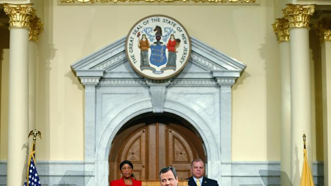 New Jersey Gov. Chris Christie gives details on his 2014 state budget in Trenton, N.J., Tuesday, Feb. 26, 2013. Christie delivers his fourth budget proposal before a joint session of the Legislature at the State House during an election year as the state rebounds from the worst natural disaster in its history. (AP Photo/Rich Schultz)