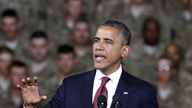 President Barack Obama speaks to troops, service-members and military families at the 1st Aviation Support Battalion Hangar at Fort Bliss, Friday, Aug. 31, 2012, in El Paso, Texas. (AP Photo/Tony Gutierrez)