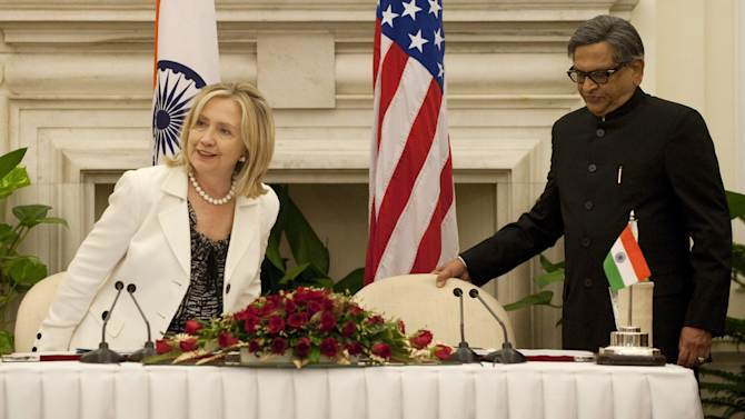 """US Secretary of State Hillary Clinton and Indian Foreign Minister S.M. Krishna hold a joint press conference during the US-India Strategic Dialogue at Hyderabad House in New Delhi on Tuesday July 19, 2011.  Clinton called for deeper regional security cooperation and trade ties in talks with Indian leaders, held in the shadow of triple bomb blasts in Mumbai. India's concerns over the US troop drawdown in Afghanistan and New Delhi's renewed peace talks with arch-rival Pakistan are expected to figure in the """"strategic dialogue"""" underway in the Indian capital. (AP Photo/ Saul LOEB, pool)"""