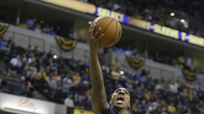 Atlanta Hawks' Jeff Teague (0) shoots against Indiana Pacers' David West during the first half of Game 1 in the first round of the NBA basketball playoffs on Sunday, April 21, 2013, in Indianapolis. (AP Photo/Darron Cummings)
