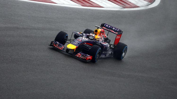 Red Bull Formula One driver Vettel of Germany drives during the qualifying session of the Chinese F1 Grand Prix at the Shanghai International circuit