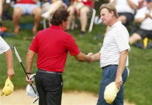 Mickelson of the U.S. shakes hands with Els of South Africa after their four ball match at the 2013 Presidents Cup golf tournament at Muirfield Village Golf Club in Dublin, Ohio