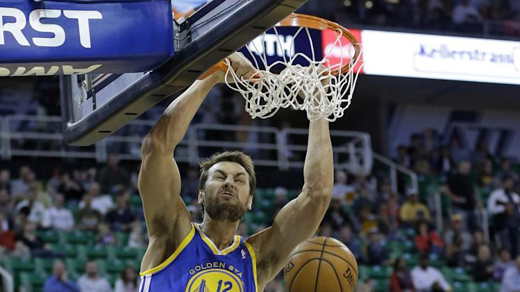 Evans helps Jazz rout Warriors