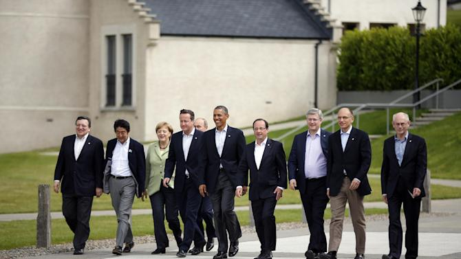 G-8 leaders from left, European Commission President Jose Manuel Barroso, Japan's Prime Minister Shinzo Abe, German Chancellor Angela Merkel, British Prime Minister David Cameron, U.S. President Barack Obama, Russian President Vladimir Putin, French President Francois Hollande, Canadian Prime Minister Stephen Harper, Italian Prime Minister Enrico Letta and European Council President Herman Van Rompuy walk prior to a group photo opportunity during the G-8 summit at the Lough Erne golf resort in Enniskillen, Northern Ireland, on Tuesday, June 18, 2013. The final day of the G-8 summit of wealthy nations is ending with discussions on globe-trotting corporate tax dodgers, a lunch with leaders from Africa, and suspense over whether Russia and Western leaders can avoid diplomatic fireworks over their deadlock on Syria's civil war. (AP Photo/Matt Dunham)