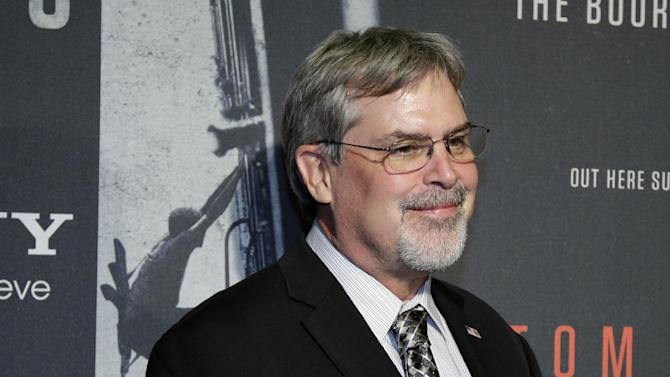 "In this Oct. 2, 2013, photo, Captain Richard Phillips, walks the red carpet at a screening for the movie ""Captain Phillips"" at the Newseum in Washington. Dramatic accounts of the Navy SEALs rescuing the captain of an American cargo ship made headlines around the world in 2009. The military said SEAL snipers killed a trio of pirates in a tense standoff. Three shots, three kills. It was the lethal, coordinated precision that has made SEALs famous and feared. (AP Photo/Alex Brandon)"
