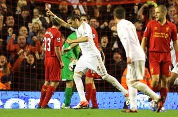 Liverpool 1-3 Swansea City: Suarez strike not enough as holder crashes out