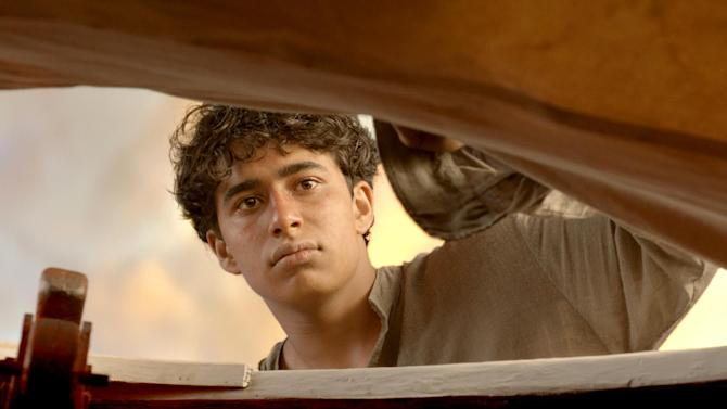 "This film image released by 20th Century Fox shows Suraj Sharma as Pi Patel in a scene from ""Life of Pi."" (AP Photo/20th Century Fox)"