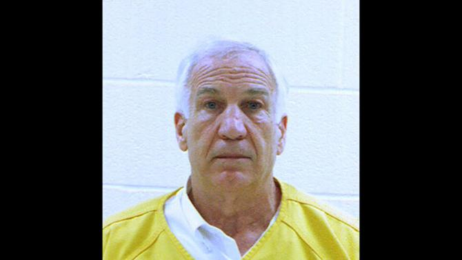 In this booking photo released early Saturday morning June 23, 2012 by the Centre County Correctional Facility in Bellefonte, Pa., former Penn State University assistant football coach Jerry Sandusky is shown. Sandusky was convicted on Friday, June 22, 2012, of sexually assaulting 10 boys over 15 years Friday, accusations that had sent shock waves through the college campus known as Happy Valley and led to the firing of Penn State's beloved Hall of Fame coach, Joe Paterno.. (AP Photo/Centre County Correctional Facility)