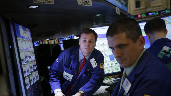 "Traders work on the floor at the New York Stock Exchange in New York, Wednesday, Jan. 2, 2013. The ""fiscal cliff"" compromise, for all its chaos and controversy, was enough to send the stock market shooting higher Wednesday, the first trading day of the new year. (AP Photo/Seth Wenig)"