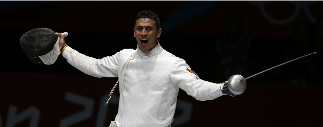 Venezuela's Ruben Limardo Gascon celebrates his victory against Seth Kelsey of the U.S. at the end of their men's epee individual semifinals at the London 2012 Olympic Games
